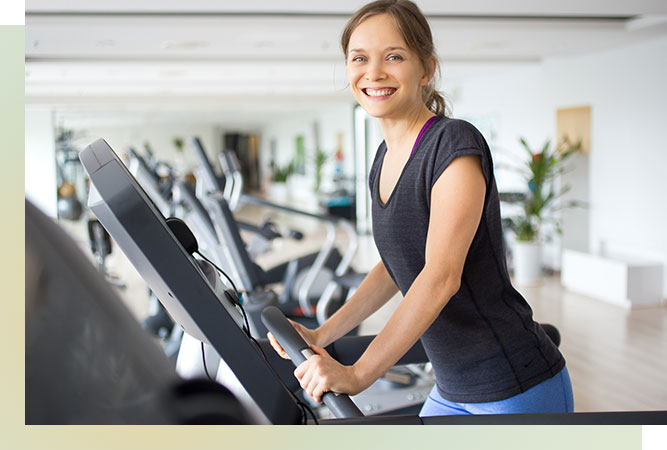 Smiling woman on treadmill.